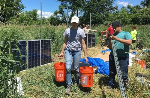 Undergraduate interns Kunal Palawat and Ernesto Vazquez put up solar panels.