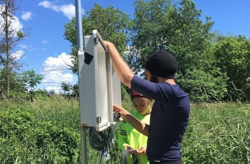Undergraduate interns Amanda Jackson-Mojica and Ricardo Feliciano set up communication between the sensors and the data logger.